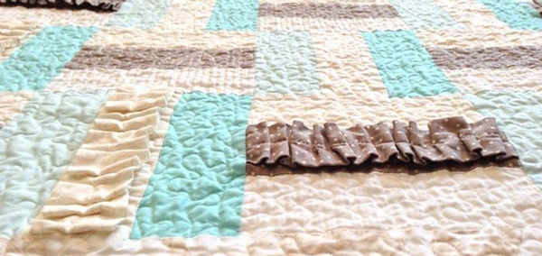 A picture of a quilt, that serves as the Connecting Quilters facebook group's cover photo